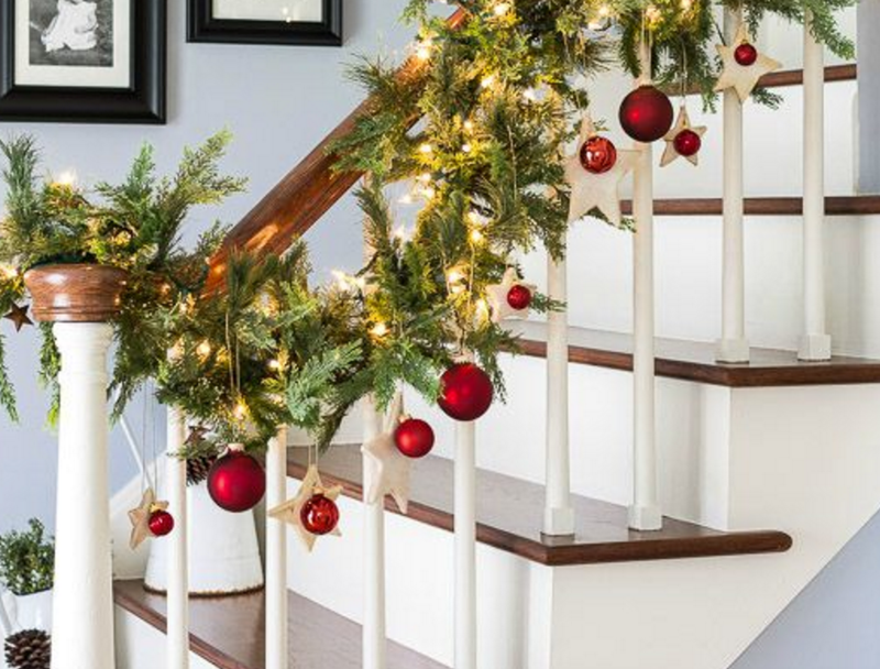 Christmas decorated stair case railings