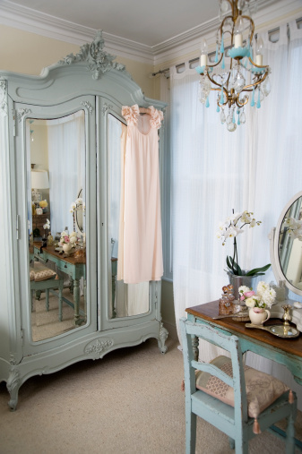 Blue closet with mirrors on the doors
