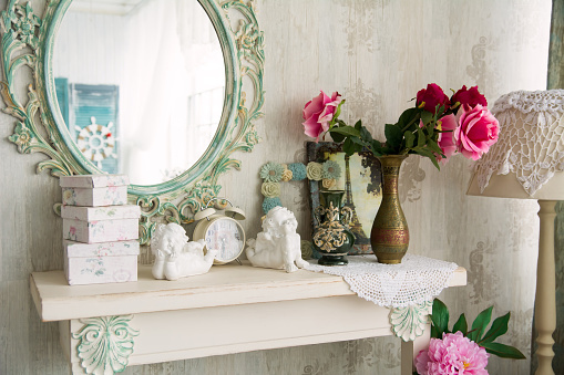 Mirror above a table on a white wall