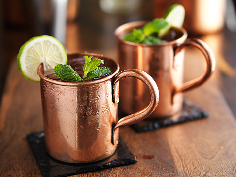 Copper mugs with green limes